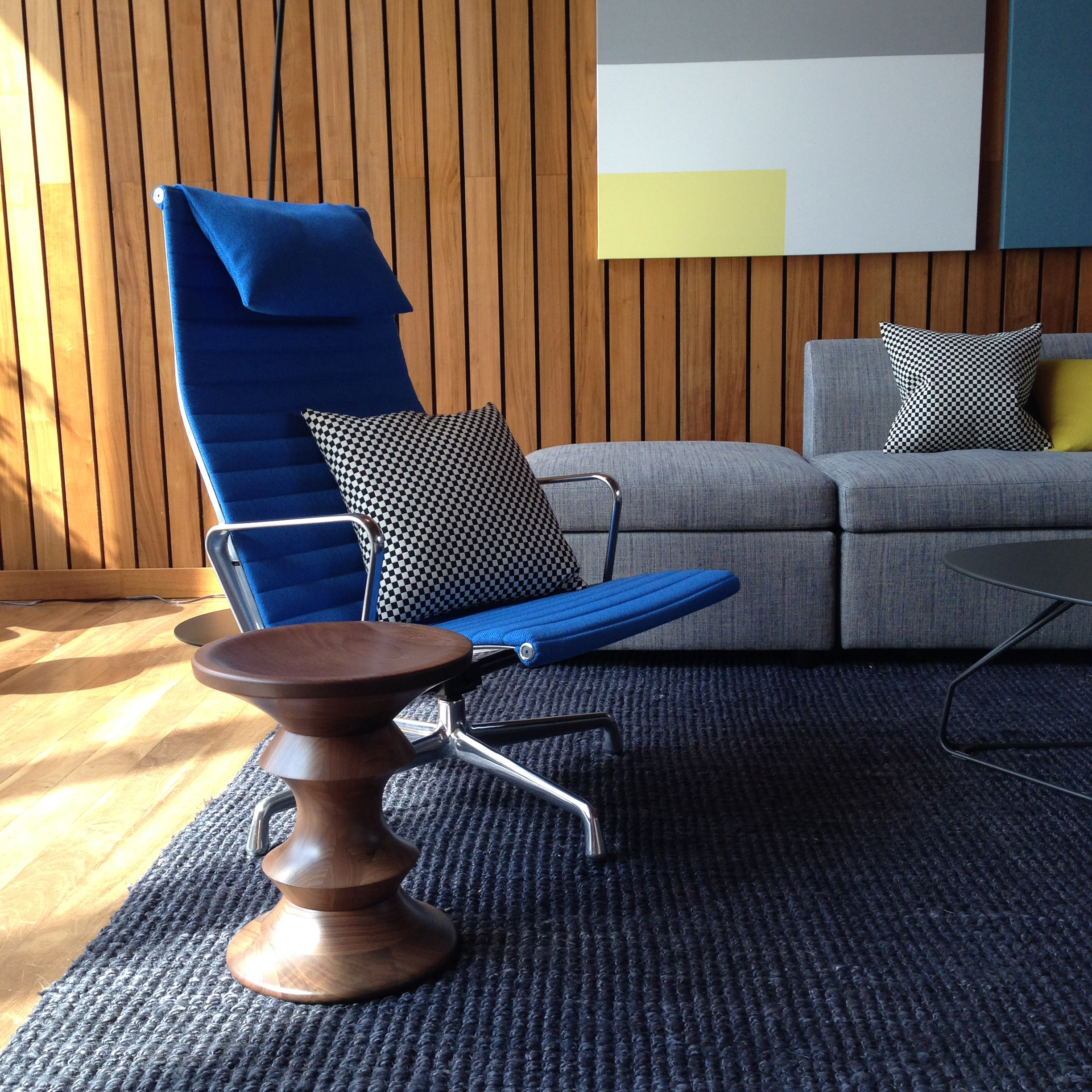 Eames Aluminum Group Lounge Chair with Eames Walnut Stool