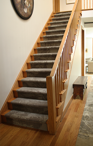 Custom Residential Staircase Carpet. Hand-tufted wool, cut & loop pile construction. Carpet Copyright Creative Matters Incorporated. Interior designed by Levitt Goodman Architects Ltd.