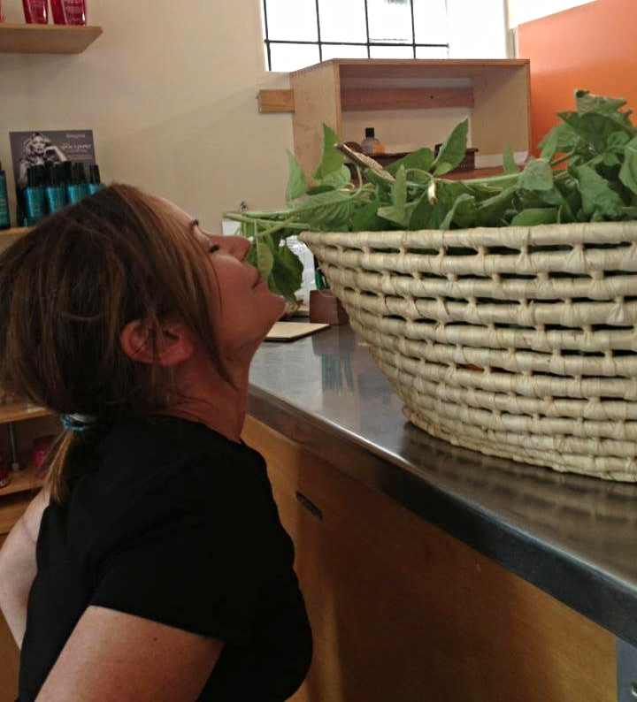 Jodi Connolly of Buzz Salon in Iowa City smells the flowers!