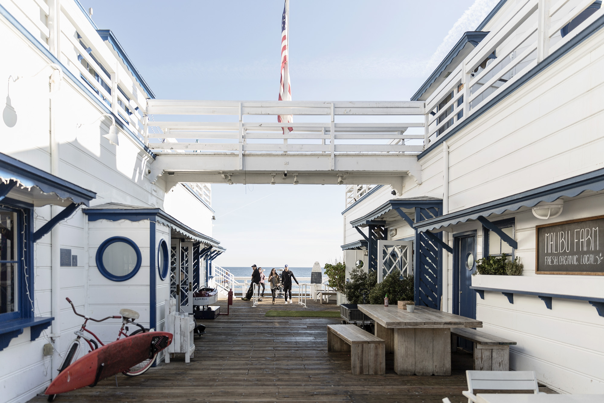 People enjoy the Malibu Pier by Denver Boulder Colorado Editorial and Commercial Photographer Rebecca Stumpf, specializing in food, lifestyle, and travel.