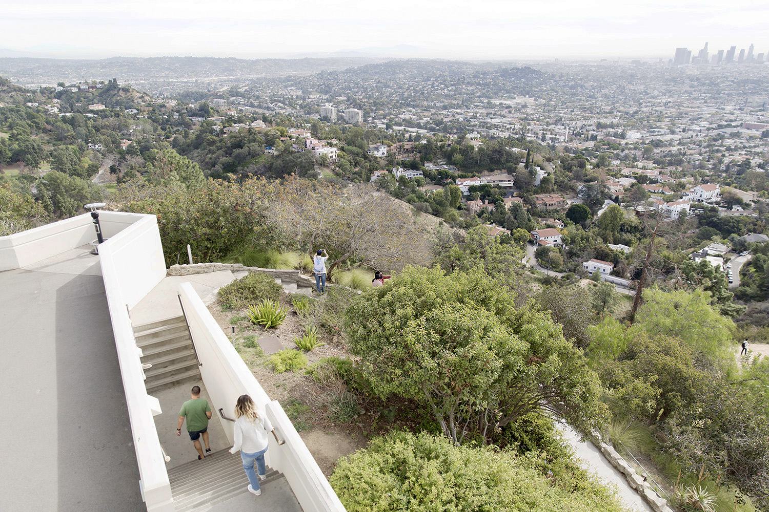 People enjoy the view over Los Angeles at the Griffith Observatory by Rebecca Stumpf, Denver Boulder Colorado Editorial and Commercial Photographer.