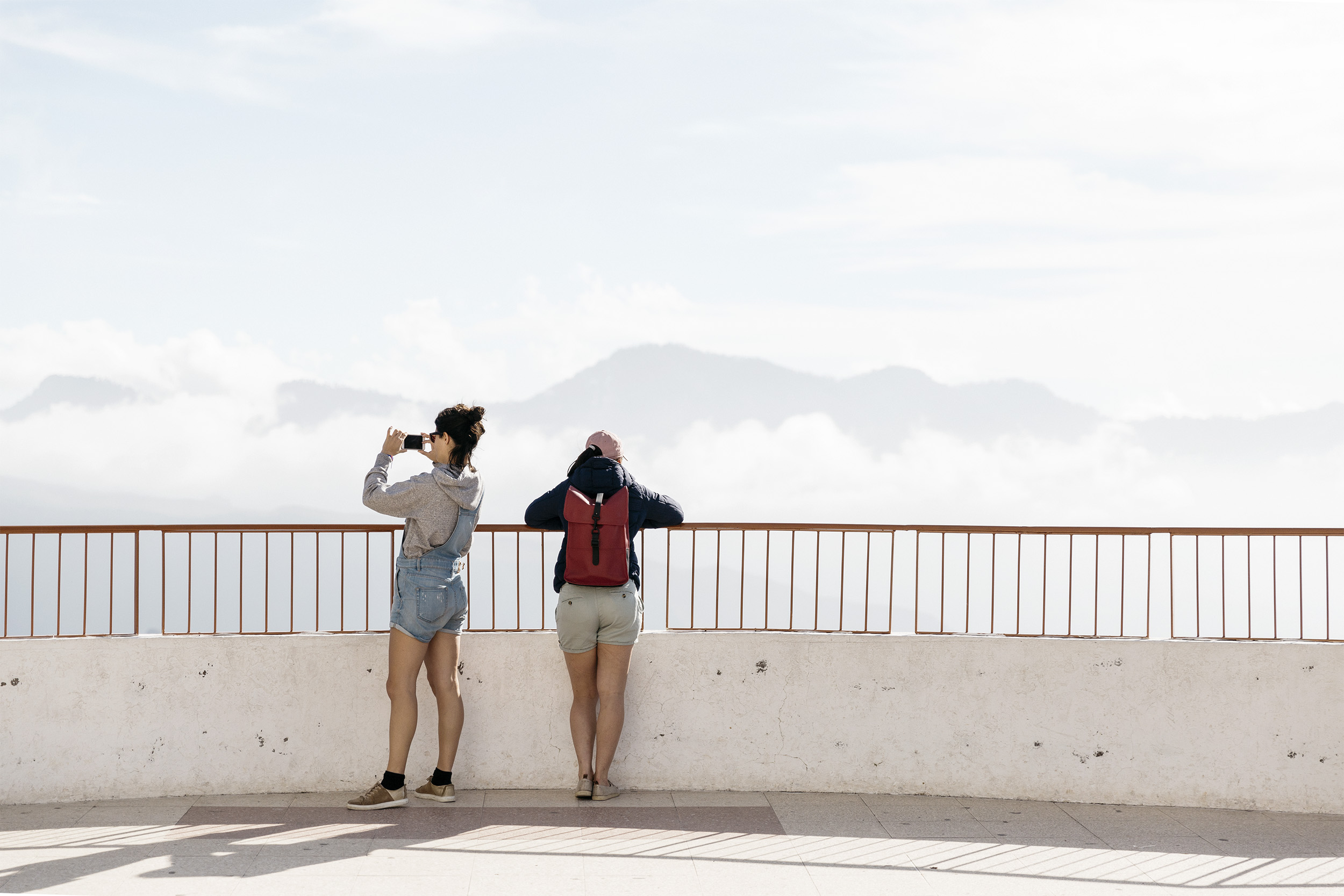 Two women enjoy the view in the Canary Islands by Rebecca Stumpf, Denver Boulder Colorado Editorial and Commercial Photographer.