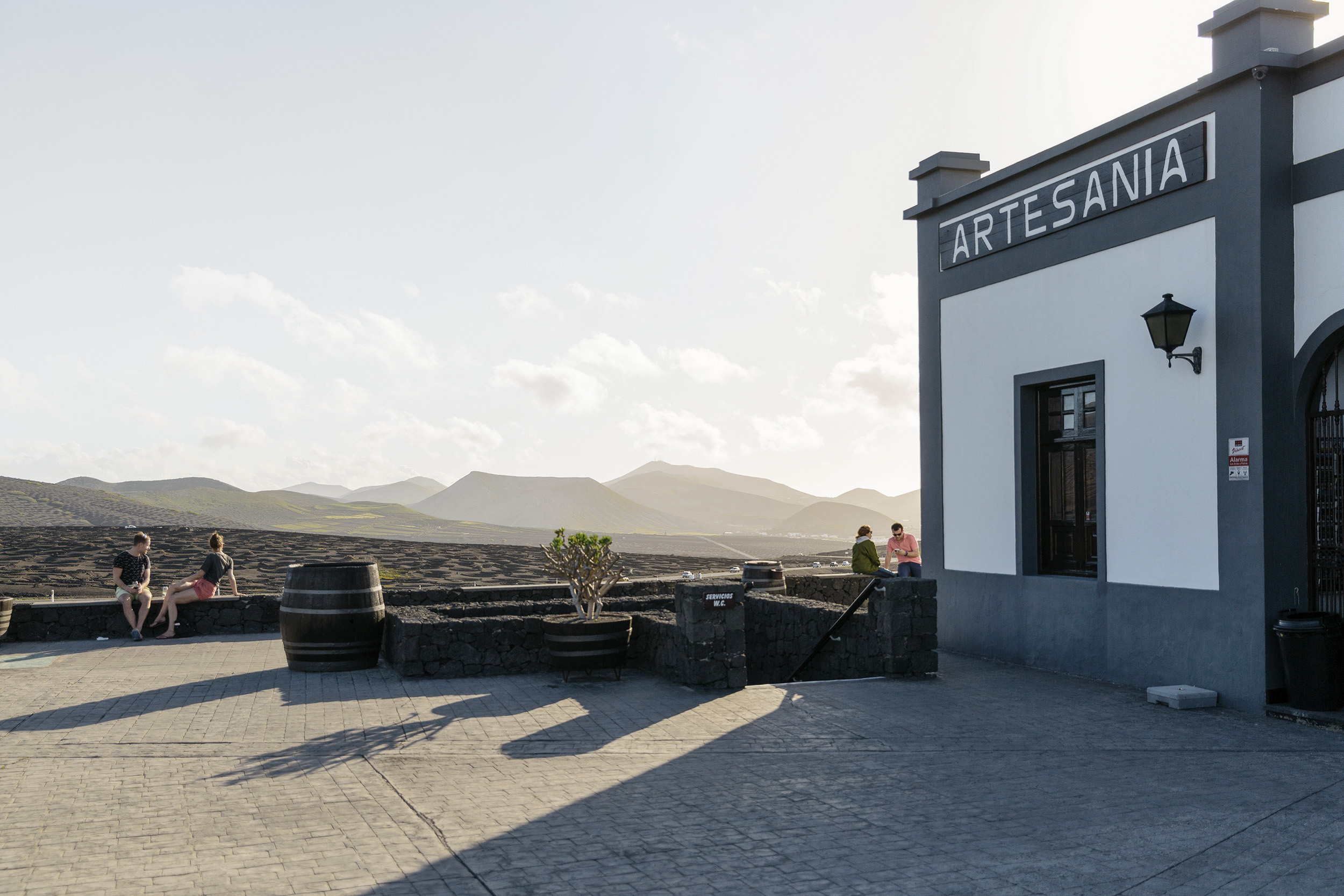 People enjoy La Geria winery in Lanzarote, Canary Islands, by Rebecca Stumpf RebeccaStumpf.Food.Travel.Lifestyle.Denver.Boulder.Colorado.Photographer