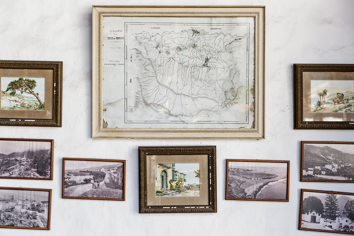 Old photos and a map from early Canary Islands history on a wall by RebeccaStumpf.Food.Travel.Lifestyle.Denver.Boulder.Colorado.Photographer