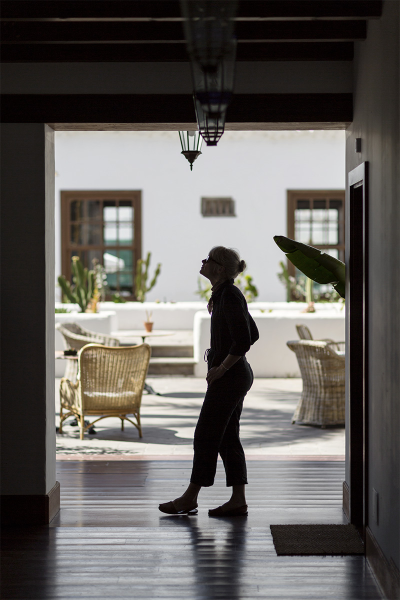 A woman looks around the courtyard at Hotel Palacio Ico in Teguise, Lanzarote, Canary Islands by RebeccaStumpf.Food.Travel.Lifestyle.Denver.Boulder.Colorado.Photographer
