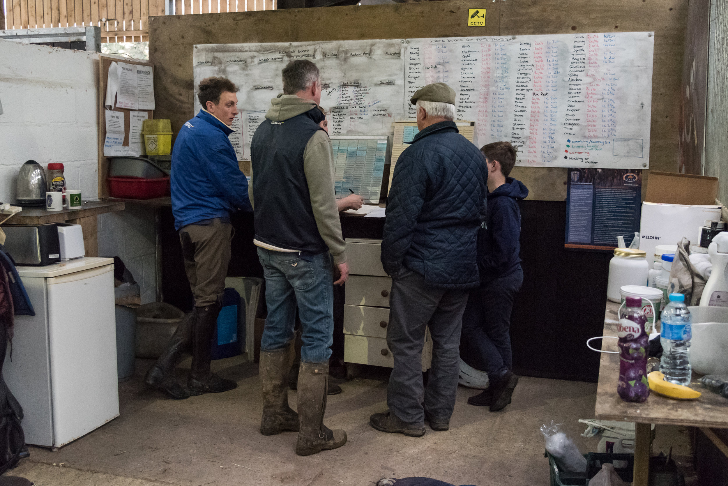 Three generations of the Tizzard family make plans for morning work.