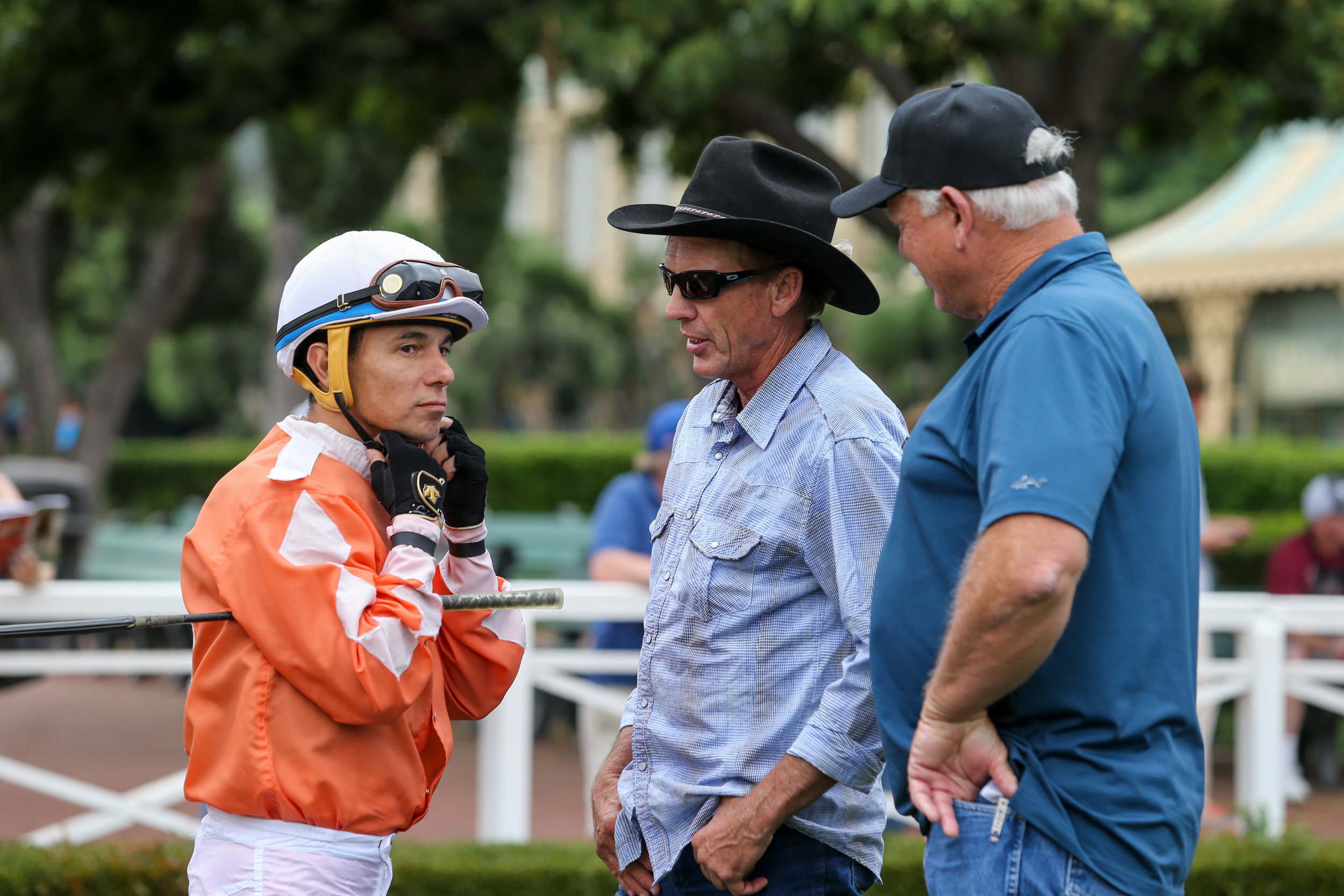 """By ED GOLDEN    The Santa Anita stable notes for April 14th (as written by Ed Golden) succinctly summarize that Val Brinkerhoff is one of the faceless trainers who drives the game.    He might be light years from being in a league with the Bafferts, Browns, and Pletchers but pound for pound, the 62-year-old Brinkerhoff has one of the most industrious operations in the land, flying beneath the radar while gaining respect from peers and bettors alike.    He's an angular version of John Wayne, cowboy hat and all, but without the girth and swagger, Brinkerhoff is a hands-on horseman from dawn till dusk.    He is a former jockey who gallops his own horses, be they at Santa Anita, Del Mar, Turf Paradise in Arizona, or his training center in St. George, Utah, where he breaks babies and legs up older horses that have been turned out.    In short, Val Brinkerhoff is a man's man, pilgrim.    It all began when he was 14 in a dot on the map called Fillmore, Utah, current population circa 2,500.    Named for the 13th President of the United States, Millard Fillmore, it was the capital of Utah from 1851 to 1856. The original Utah Territorial Statehouse building still stands in the central part of the state, 148 miles south of Salt Lake City and 162 miles north of St. George.    But enough of history.    """"My dad trained about 30 horses when we lived in Fillmore,"""" said Brinkerhoff, a third-generation horseman. """"I would ride a pony up and down a dirt road outside our house every day, and that's how I learned to gallop horses.    """"There was no veterinarian in Fillmore, so you had to learn how to be a vet on your own, on top of everything else, because it was 300 miles round trip to a vet. So, if something was wrong, you had to figure it out for yourself without having to run to Salt Lake and back every five minutes.    """"I was 5' 10'' and weighed 118 pounds and rode at the smaller venues, mainly in Utah but also Montana, where I was leading rider, and Wyoming and California (Fairplex """