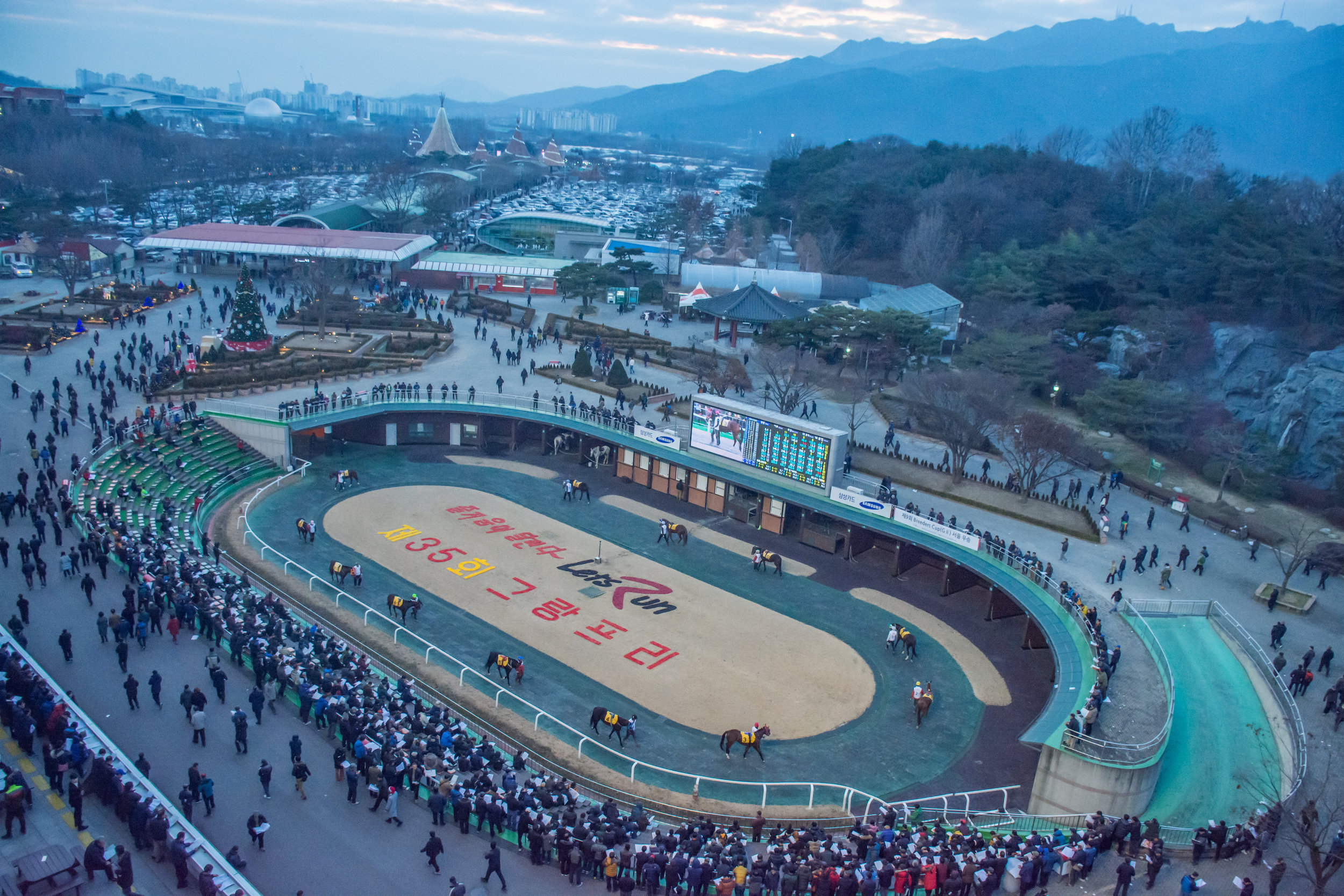 """Horseracing in South Korea:    A GLOBAL VISION      On the evening of January 19, 2017, something special happened in Dubai. To the casual spectator it might have seemed like any other horse race, but to viewers in the Republic of Korea, the 1200m District One Handicap at Meydan was a watershed moment in their nation's sporting history. The winner of this race was Main Stay, a four-year-old colt trained by Kim Young Kwan and the first Korean-trained horse to win at a significant international meeting since Thoroughbred horse racing was established in South Korea almost 100 years ago. What is more, the winner carried the (KOR) suffix in the racecard, underlining the fact that the country is now capable of producing internationally competitive Thoroughbreds.      Yet as Main Stay crossed the line on that fateful night, even switched-on racing enthusiasts and professionals with a broad international perspective may have asked, """"So they race in Korea?""""      Indeed, this otherwise significant nation's racing industry remains relatively unknown across the globe. Recent developments have brought Korean racing into the spotlight however, and notable domestic and international expansion projects put in place by the Korea Racing Authority (KRA) could soon see it established as an influential player on the global racing scene.      CONTEXT    In sporting terms, South Korea would most commonly be associated with taekwondo, baseball, soccer, or even figure skating. Yet horseracing is in fact the country's second most popular spectator sport after baseball, with annual attendance of over 15 million. What is more, betting turnover stands at around $6.5 billion USD per annum, the seventh-highest in the world, meaning that horseracing in Korea already boasts figures that some of the most celebrated racing nations can only dream of.      Despite massive obstacles such as Japanese occupation (1910-1945), partition (1945), the Korean War (1950-53), and an ongoing state of tension with """