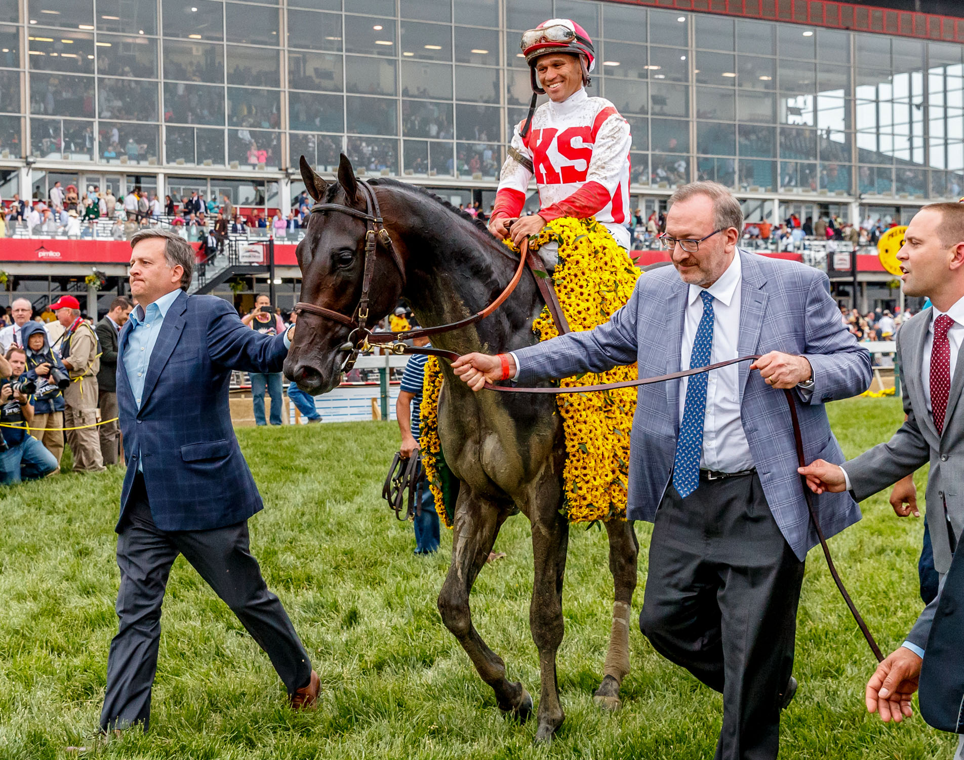 Cloud Computing owners, William Lawrence (left) and Seth Klarman (right) with trainer Chad Brown (far right)