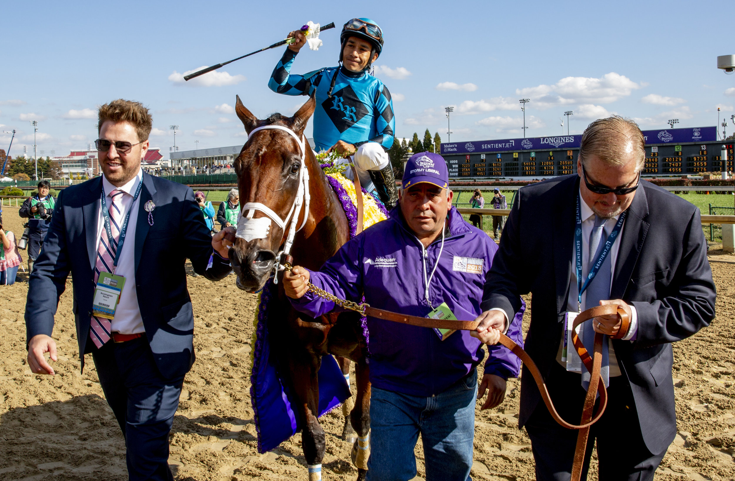 Gary Hartunian (right) leading Roy H, winner of the Twinspires Breeders' Cup Sprint