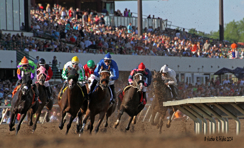 """When the gates open for Canterbury Park's first race on May 3, 2019, it will mark the 25th season of operation under public ownership led by the Sampson and Schenian families. Minnesota racing was down and out for the count after debuting in 1985 at then-Canterbury Downs with much fanfare and seam-bursting crowds. Through management changes and the development of Native American gaming just down the street at Little Six and then Mystic Lake, the track spiraled downward into unprofitability before being mothballed by Ladbrokes in 1993.  In 1994, Curtis Sampson and Dale Schenian stepped in, reopened the racetrack and began the great Minnesota racing turnaround. One of Curtis' sons, Randy, is the track's current CEO and president while another son, Russell, runs the family's racing and breeding operation.  """"That's the only reason this racetrack is here,"""" said Andrew Offerman, Canterbury's Senior Director of Racing. """"Horsemen bought it because this is what they wanted to do. There are certainly still differences of opinion between management and horsemen on what should be done on some issues, but the differences are so minor compared to what faces other places because of the people that are here running things.""""  """"We are fortunate here in Minnesota,"""" said Kay King, Executive Director of the Minnesota Thoroughbred Association, """"that track management, the HBPA, owners, trainers—everyone can work together on a common cause. There is not the friction that you hear about elsewhere. I have people from other states tell me that they can't believe that the MTA and the MQHRA work together on issues and put on a barbeque for backside workers together because in their states the Thoroughbred and quarter horse folks couldn't get along long enough to do that.""""  The track still had to compete with Native interests as well as stiff competition for the recreation dollar in the Minneapolis/St. Paul metropolitan area.  In 2012, the Shakopee Mdewakanton Sioux Community (SMSC)—proprietors """