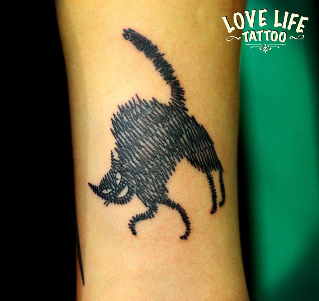 татуировка черной кошки