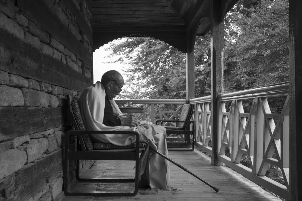 Rinpoche says his own prayers on his verandah