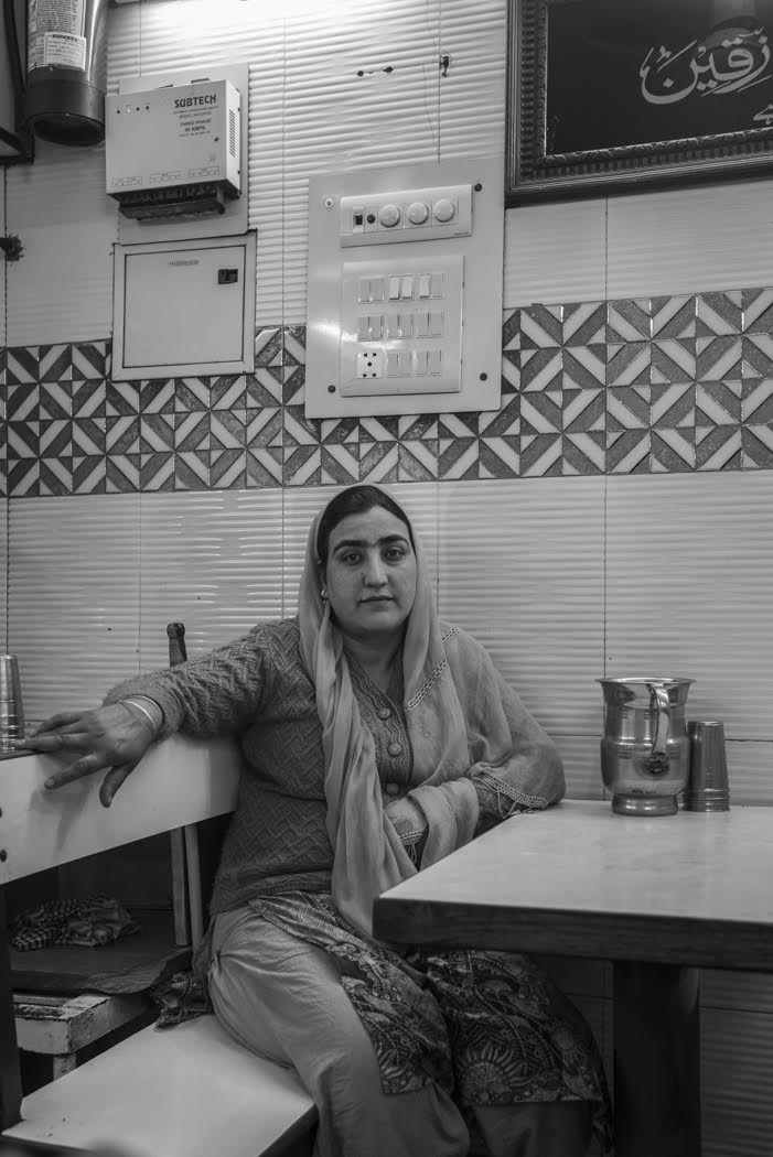 and a Kashmiri lady await her tea beside the grand Jama Masjid