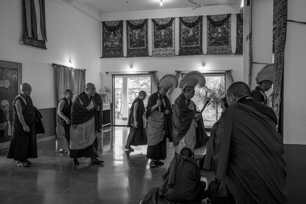 The Disciplinarian, ex-Abbot and I hold incense sticks as we lead Rinpoche into our temple
