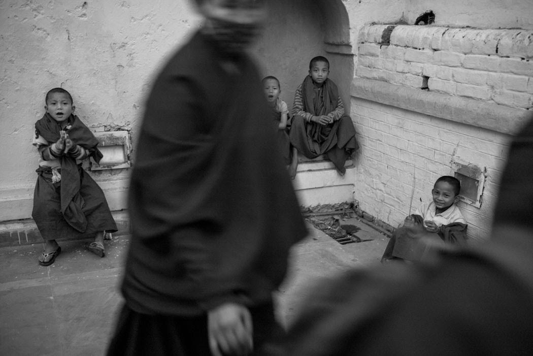 Young monks pray, play