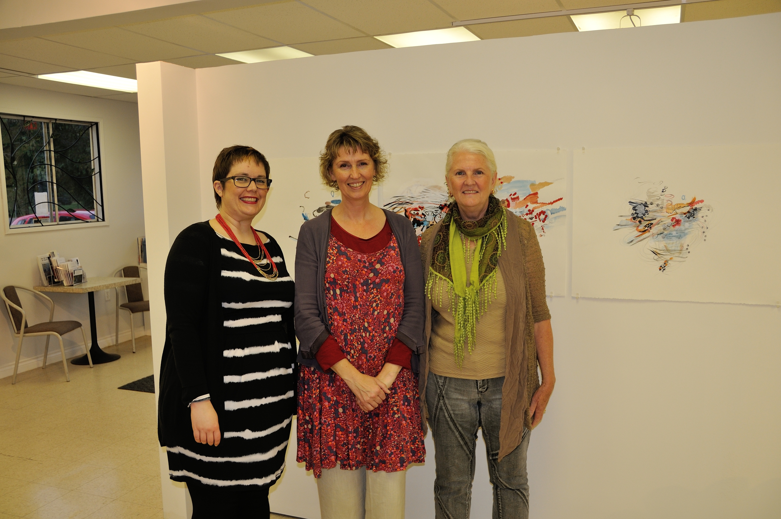 "Katie Brennan, Petrina McNeil and Jill Ehlert, standing in front of my Tryptych ""Crossover""."