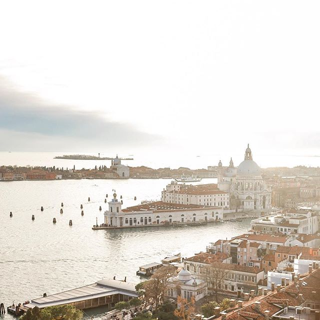 Making the most of some brief sunshine. View from the Campanile to Dorsoduro and Giudecca in lovely Venice, Italy.