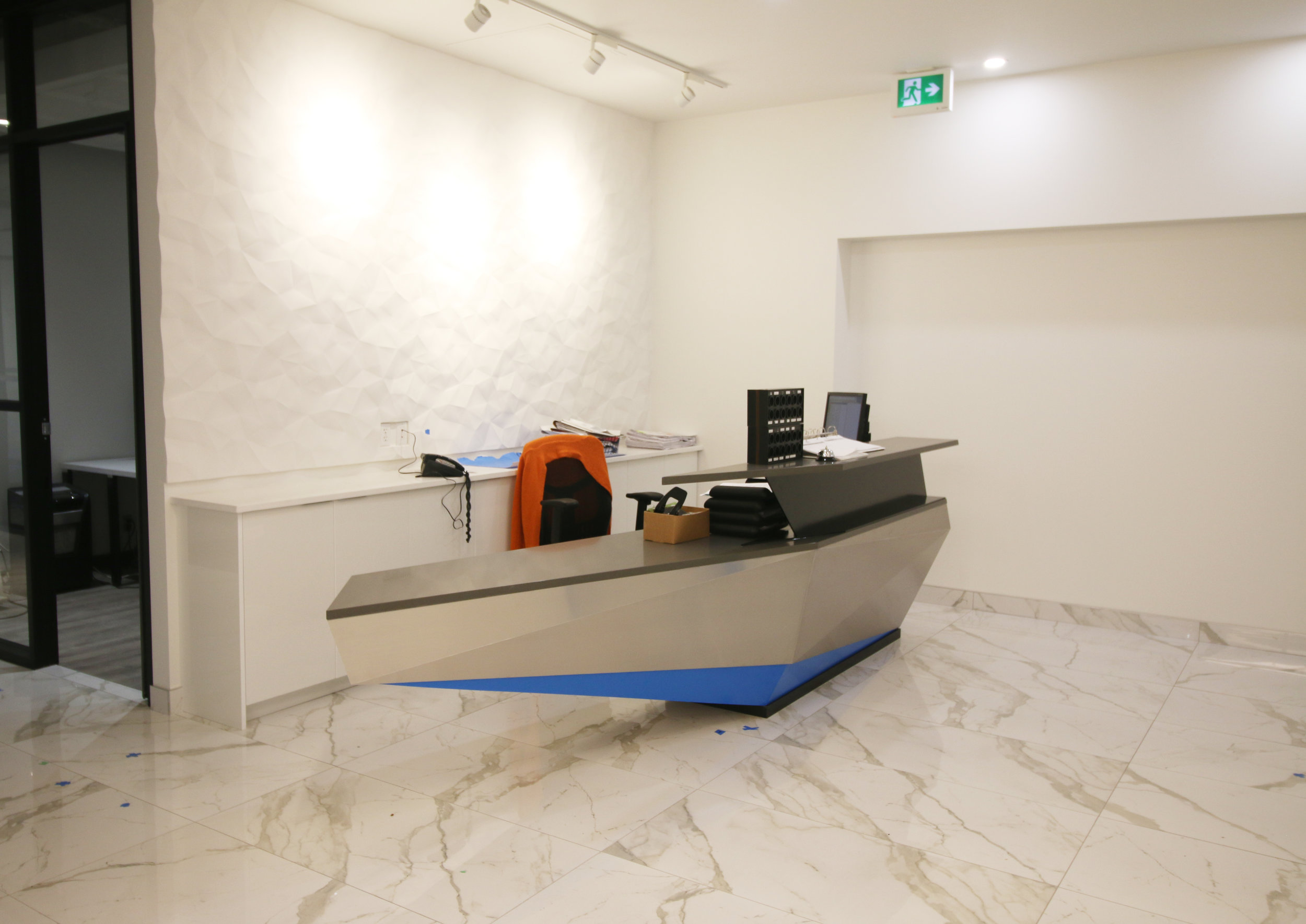 Reception + sculptural desk