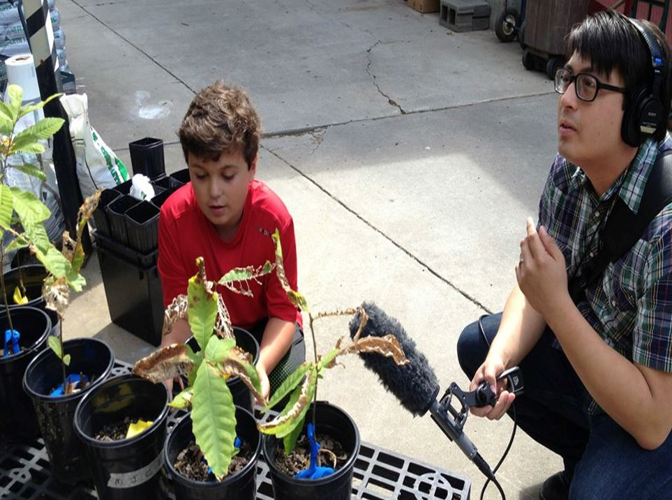 WABE's Myke Johns interviews a Chestnut camper during the summer of 2013