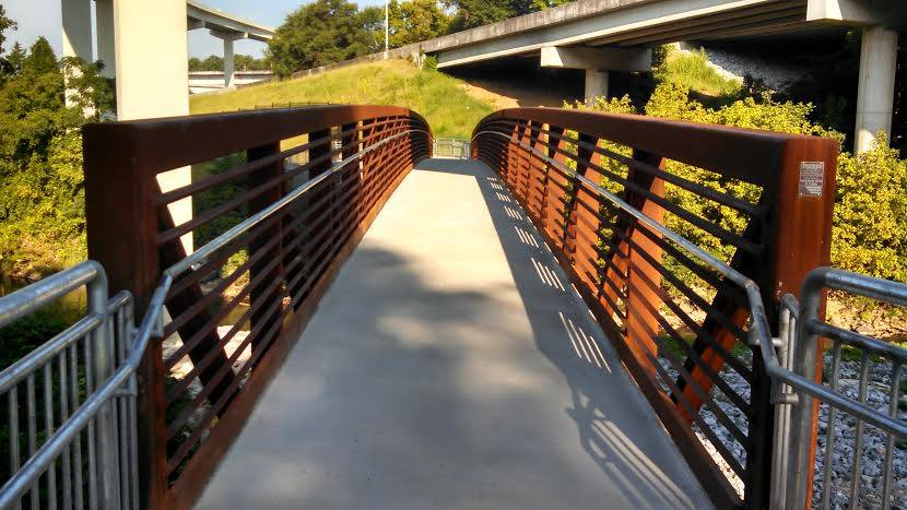 The remarkable bridge crossing the creek on the Cheshire Farm Trail