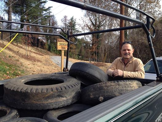 Michael Montgomery's tireless energy tucked up twelve tires tossed illegally in the creek. Thanks Michael!