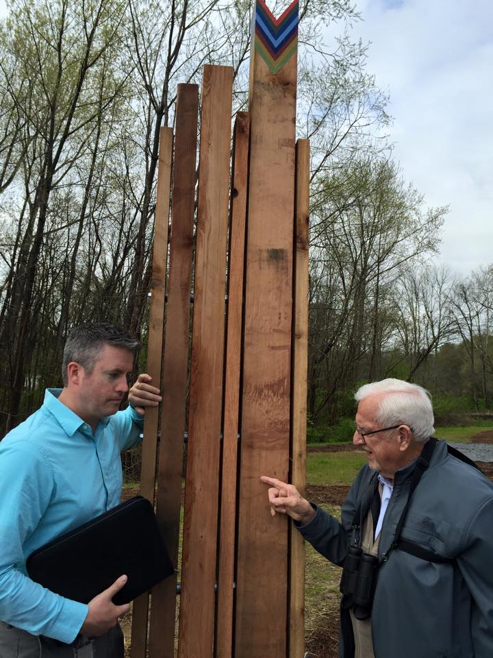 US Fish and Wildlife scientist Kevin Lowry inspects the new posts with South Fork Board Chair Bob Kerr, right.