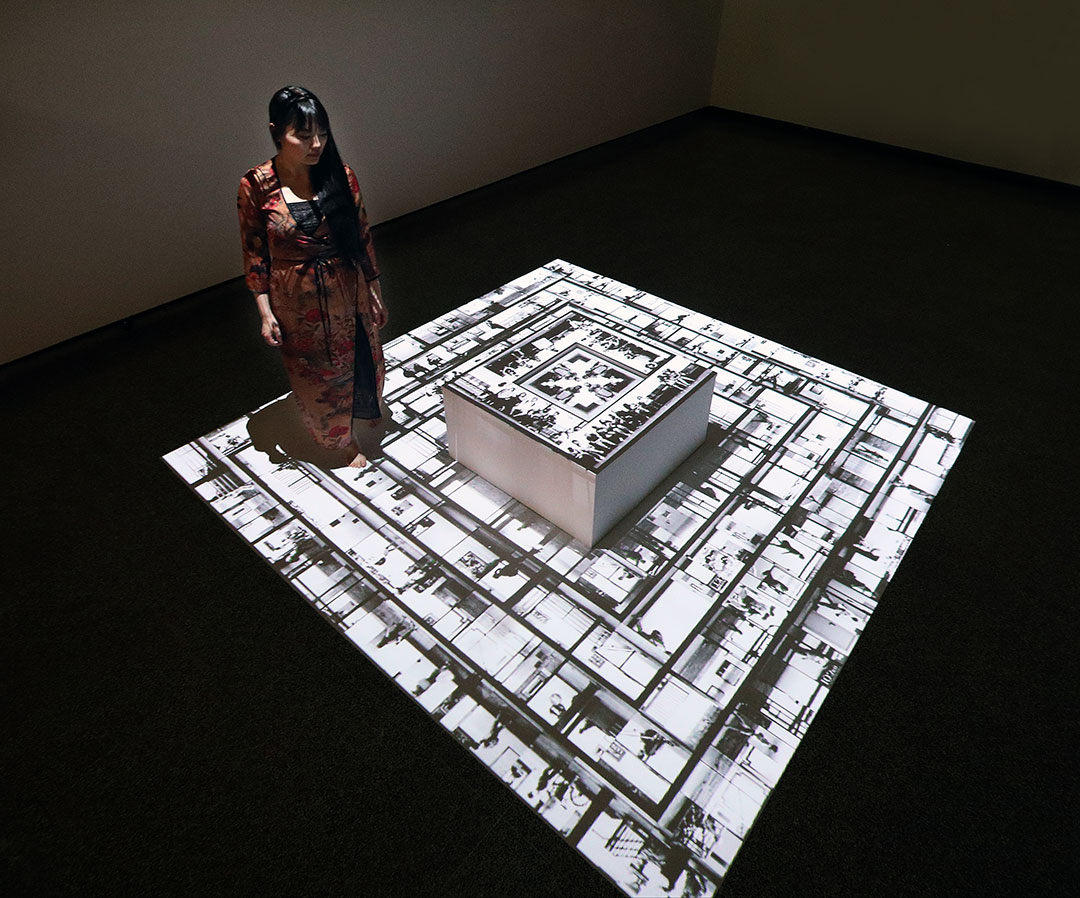 Artist Yuge Zhou with the installation