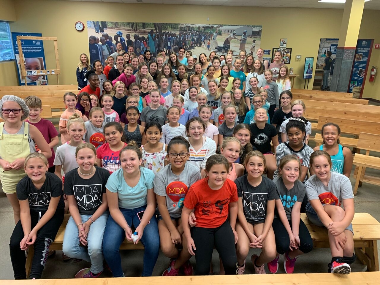 To kick off our 2019-20 Dance Season, MDA team members volunteers at  Feed My Starving Children . We had 120 dancers, parents and teachers take time out of their Saturday to volunteer at this event! At MDA we love providing opportunities for our students to give back and we are so grateful that so many of our families value this as well! MDA volunteers packed meals to be sent to Haiti. In just under 2 hours, over 39,000 meals were packed, which can feed 109 kids for 1 year!