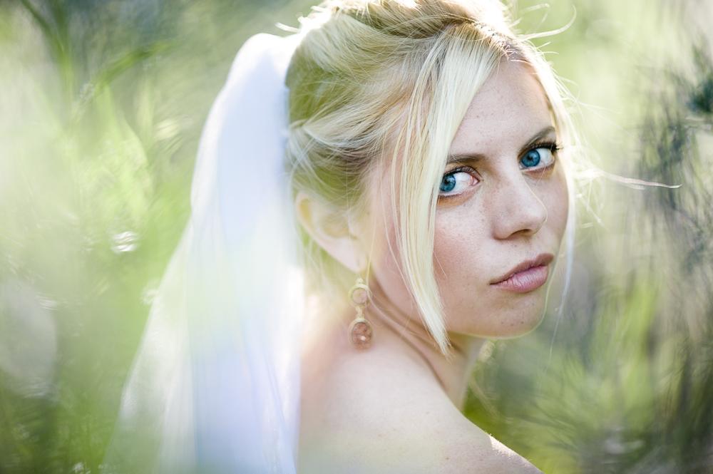 blonde bright blue eye bride portrait