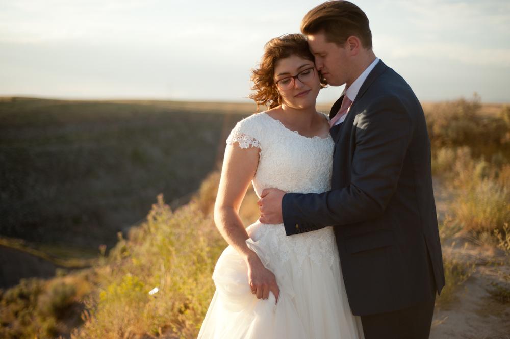 Golden gorgeous wedding photo at the teton dam