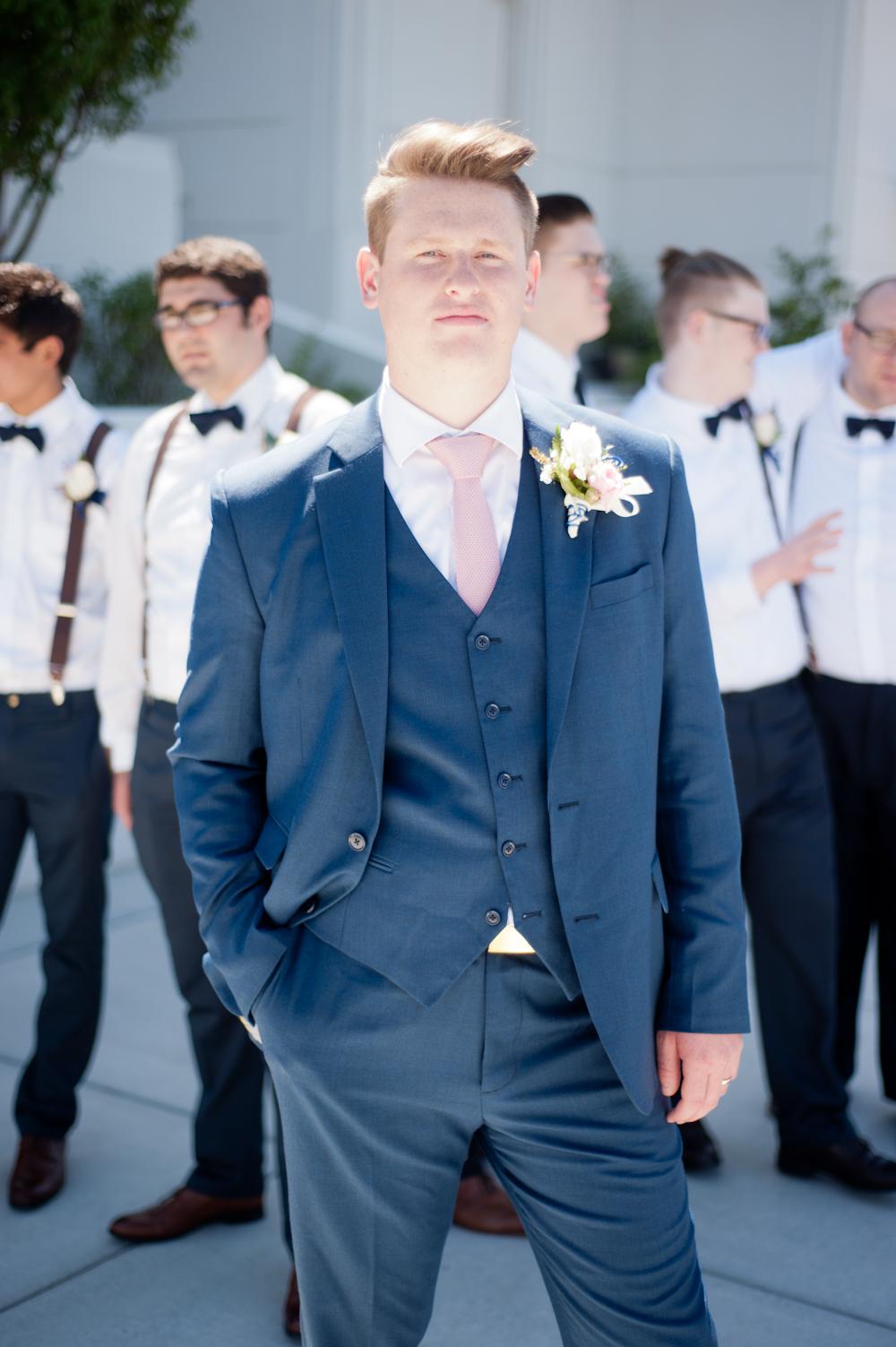 cool Groom in front of his groomsmen