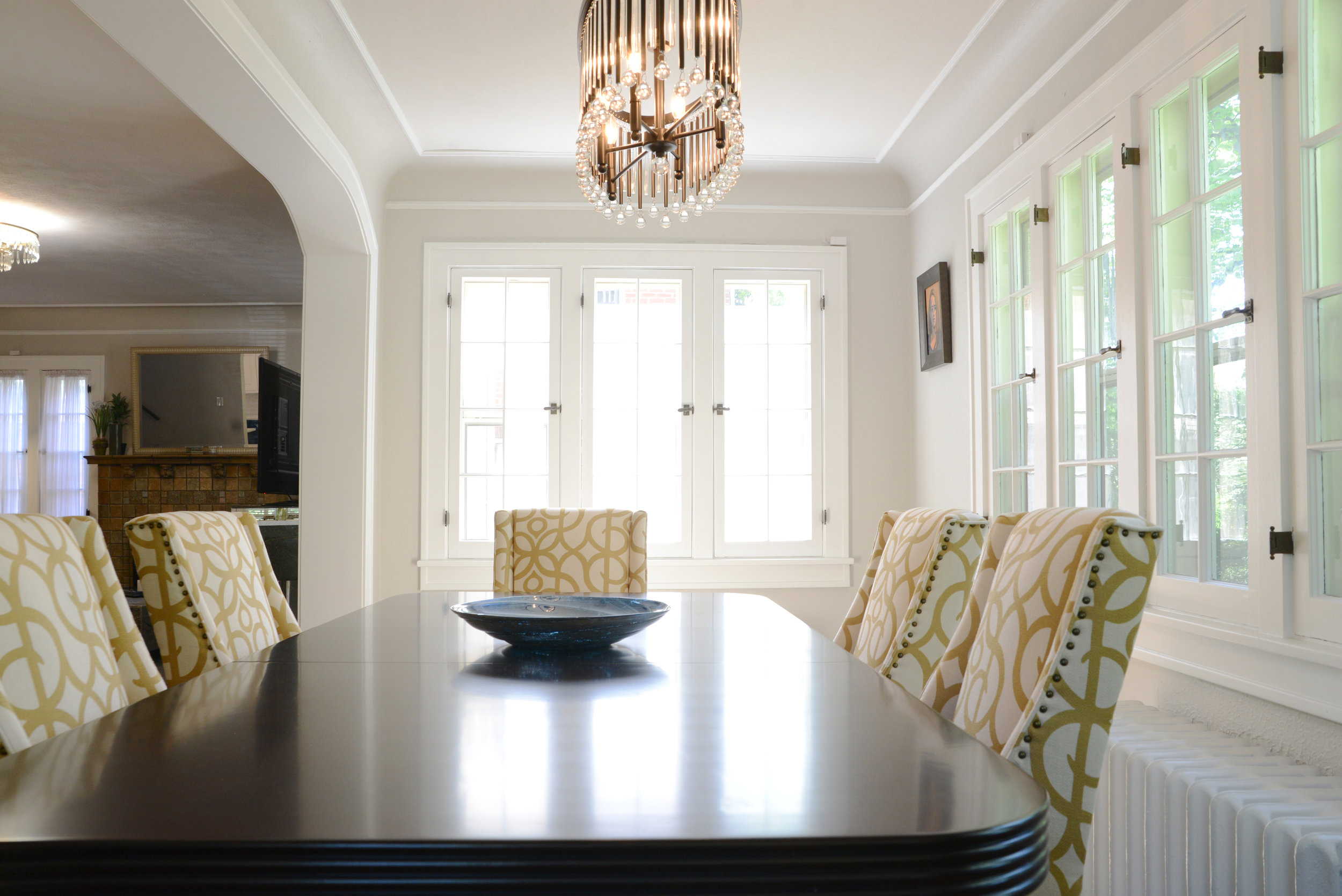 dark table with yellow accent chairs great room
