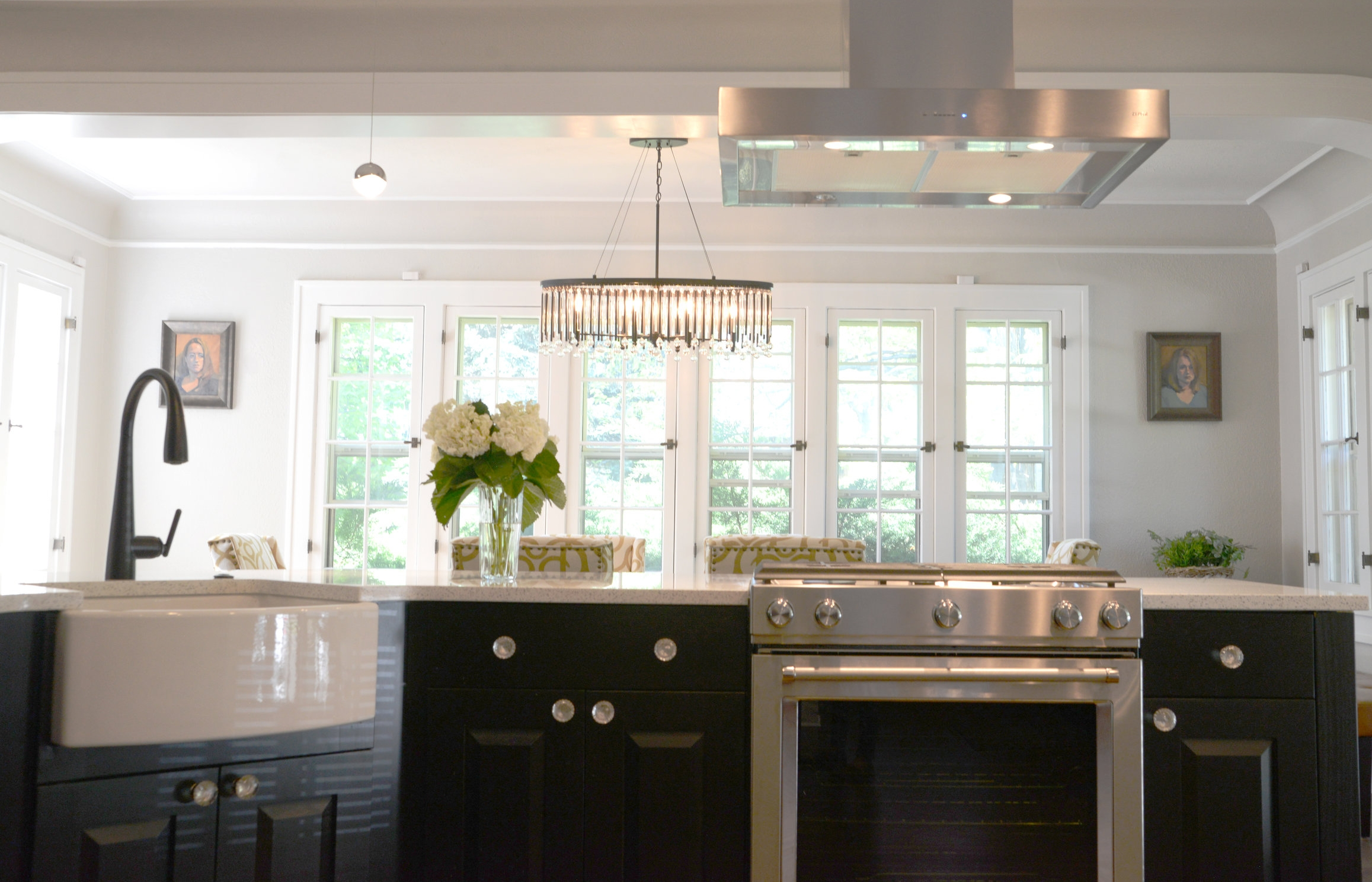 Kitchen and dining with farmhouse sink and open windows