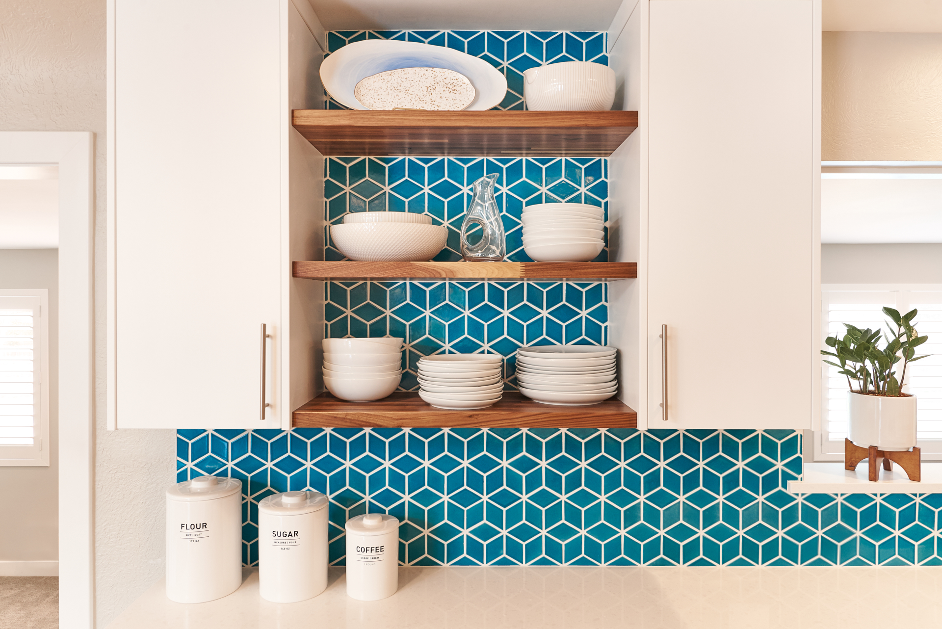 Modern open shelving for dishes and an interior design flair in colorado with an accent backsplash