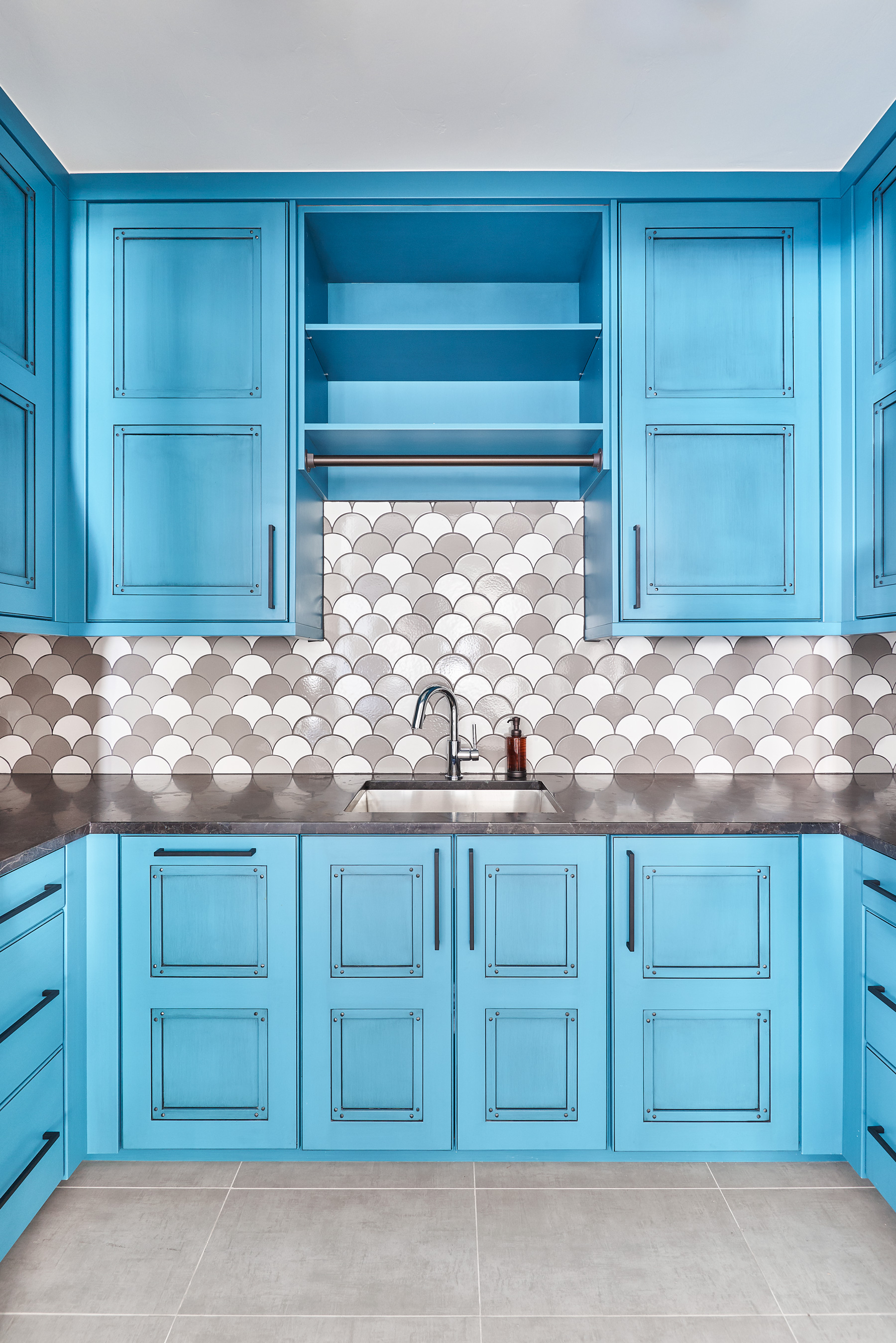 Laundry room blue cabinet interior design.jpg
