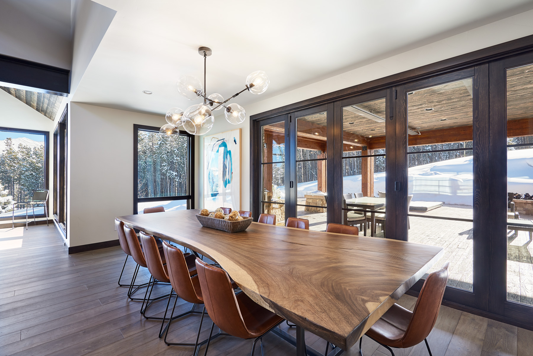 Dining room wood table montain seating 12 chandelier.jpg
