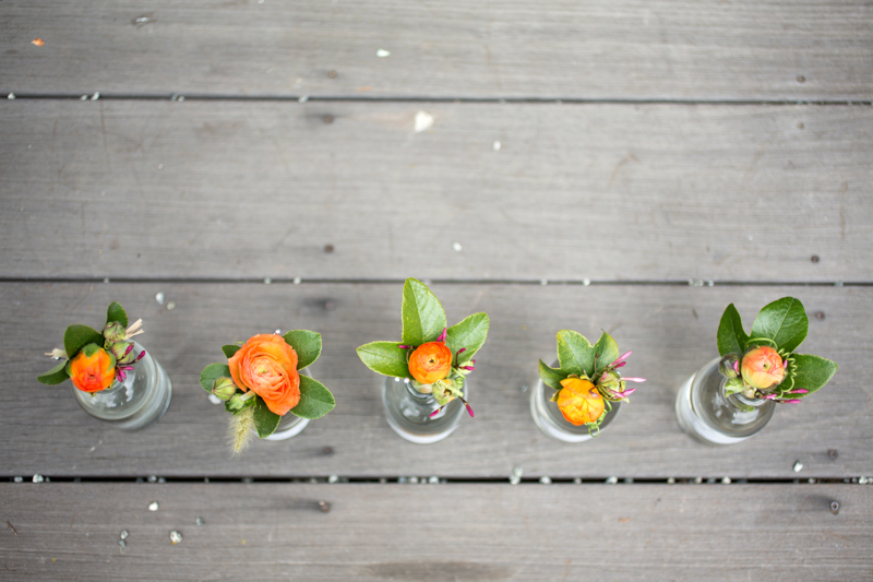 Bright and cheery boutonnieres with passion vine tendrils.