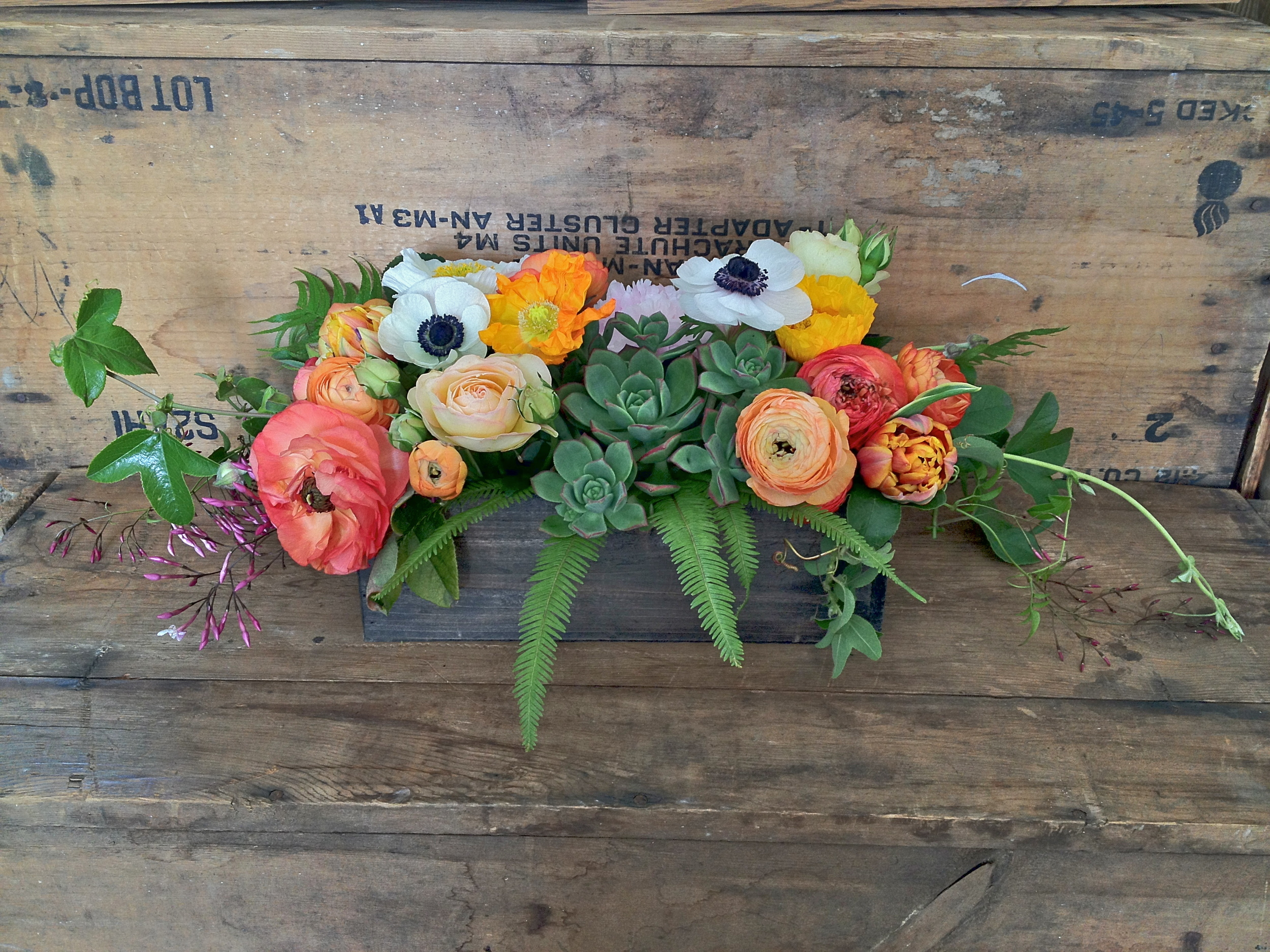 These bright and lush centerpieces were arranged in rustic wood boxes. The end result was beautiful, romantic, laid back, and natural.