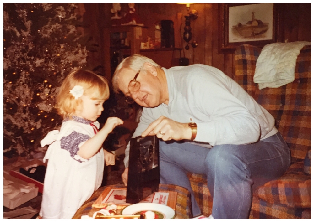 Little E with Grandpa.... all curious about LIFE and sh&t!
