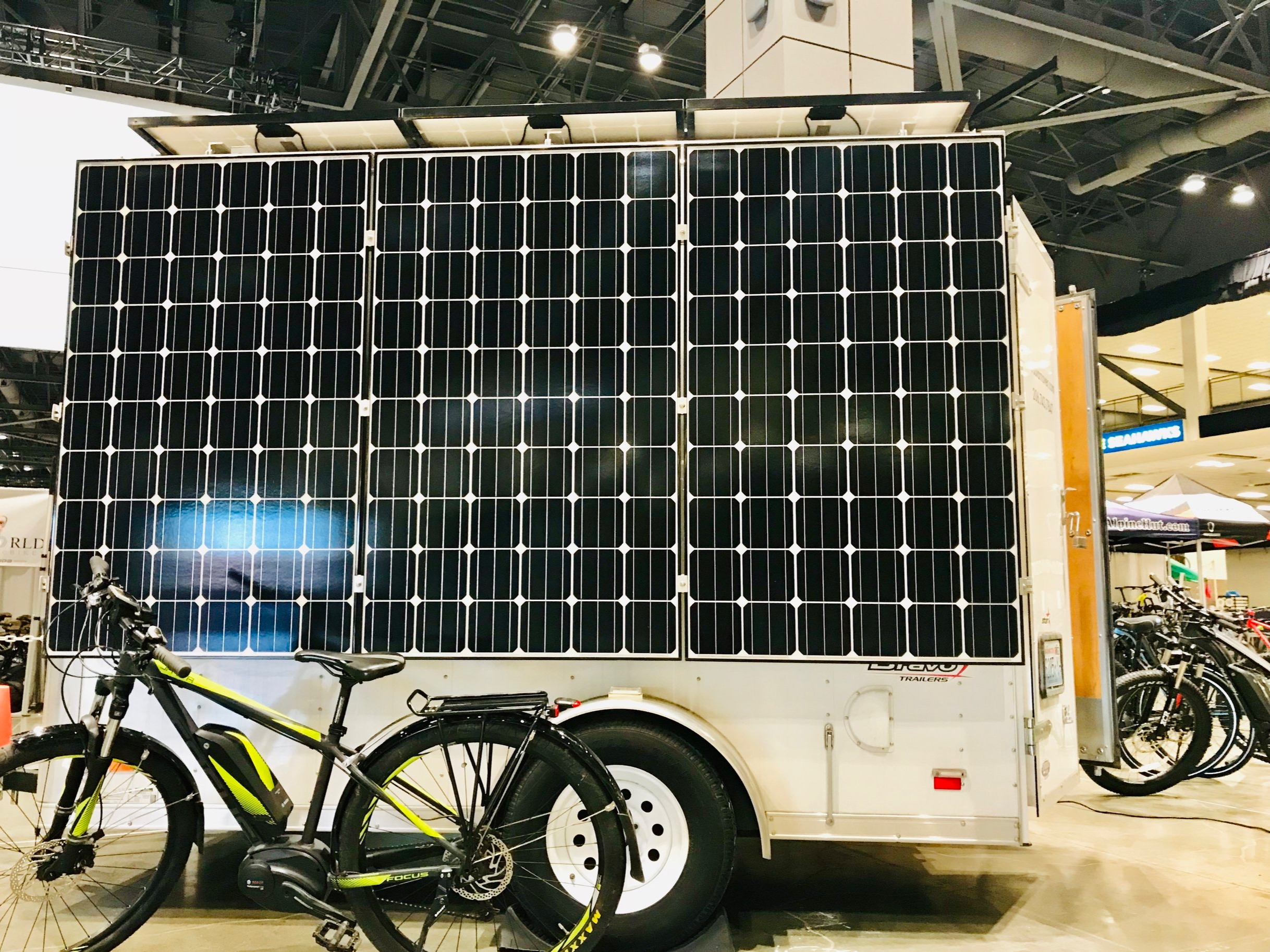 Inside solar power! Charging electric bikes at the Seattle Bike Show.