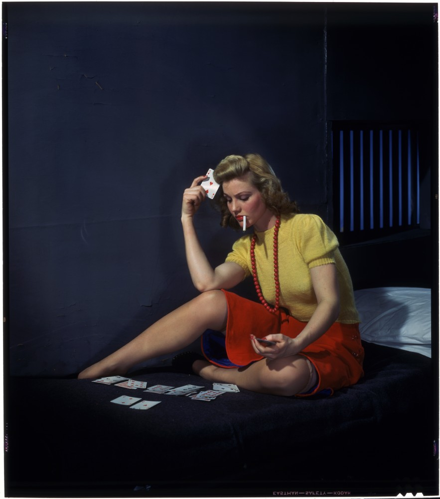 A woman playing solitaire.