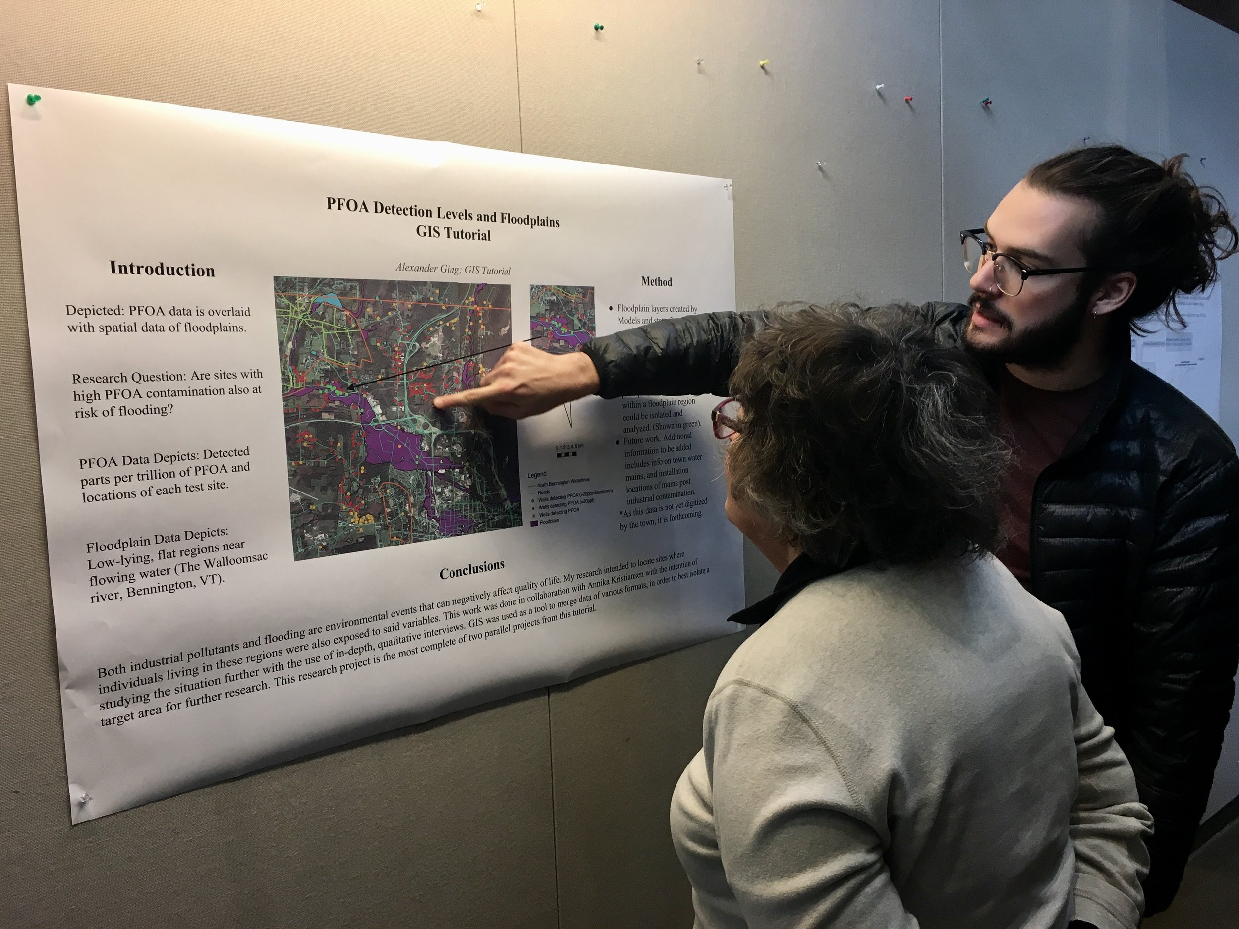 Alexander Ging '19 presents his Geographic Information Response poster to Dr. Betsy Sherman.