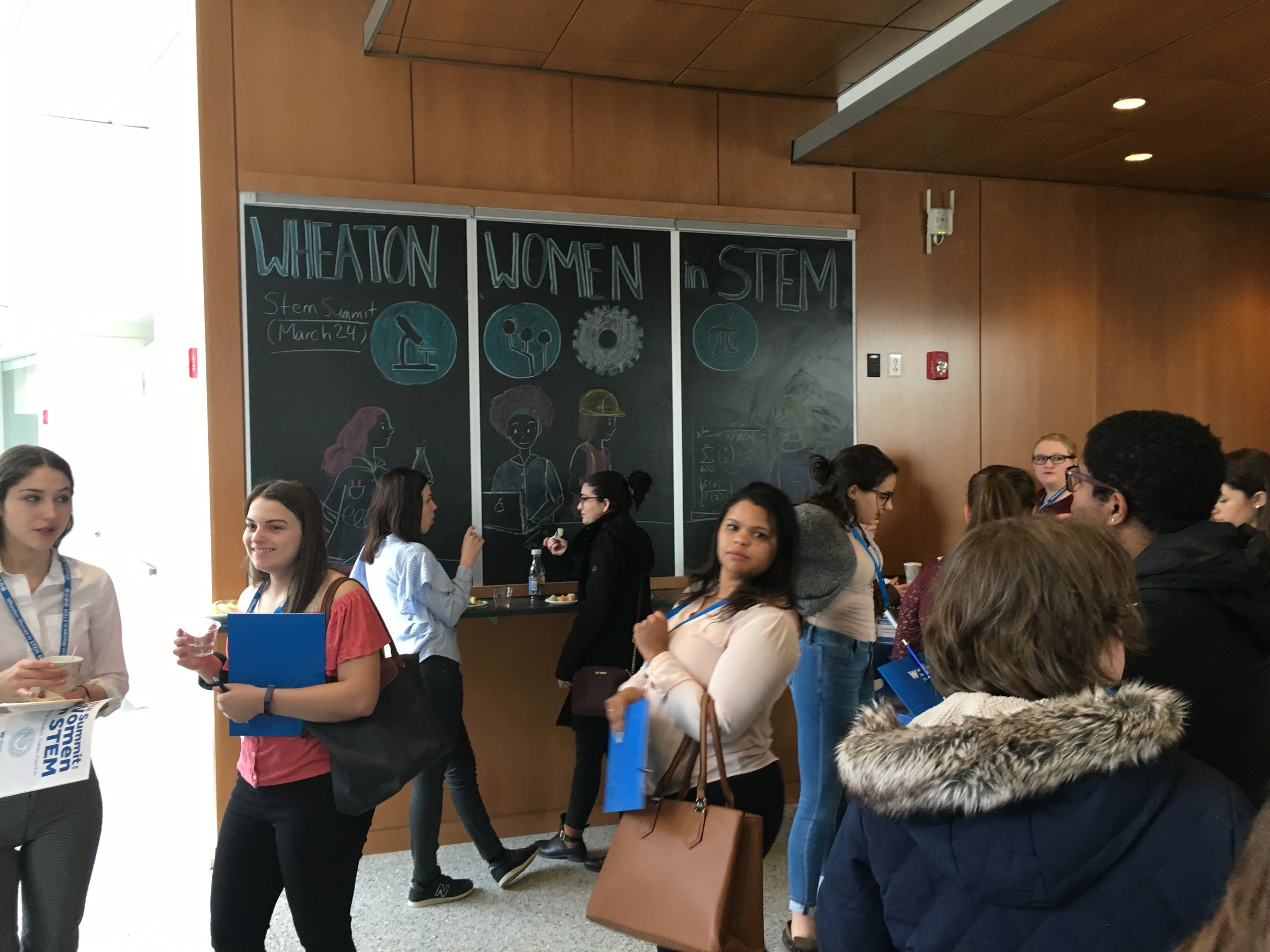Conference attendees gather in the Wheaton science building.
