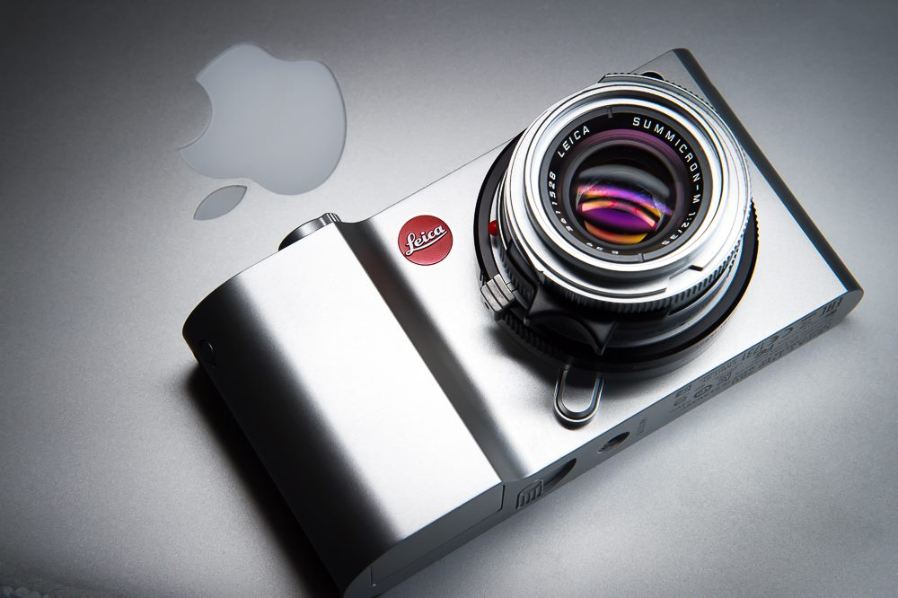 Leica T with Summicron-M 35/2 V4 using T-adapter sitting on Apple Macbook Pro