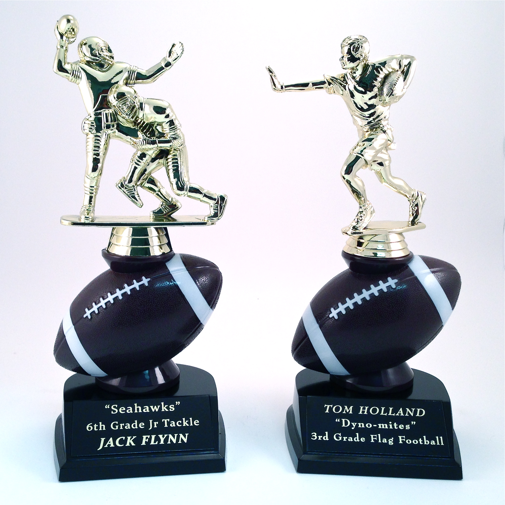"""Football Figures on a Football Riser. 9.5"""" Tall! Choose """"Stiff-Arm"""" or """"Tackle"""" Figures.$9.96 each (includes tax & engraving). [ITEM#:  16D ]"""