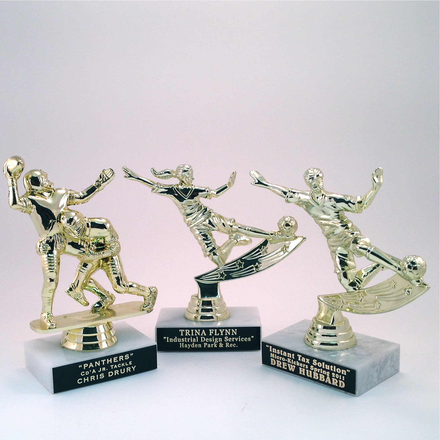 Economy Figures on Marble base - $5.30 each (Includes tax & engraving). [ITEM#:  16E ]