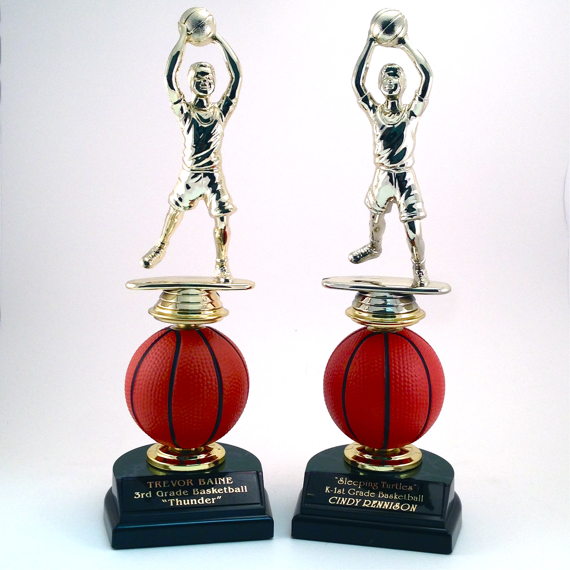 Basketball Player on Spinning Ball -  $9.96 each  (Includes tax & engraving). Specify Male or Female. [ITEM#:  14J ]