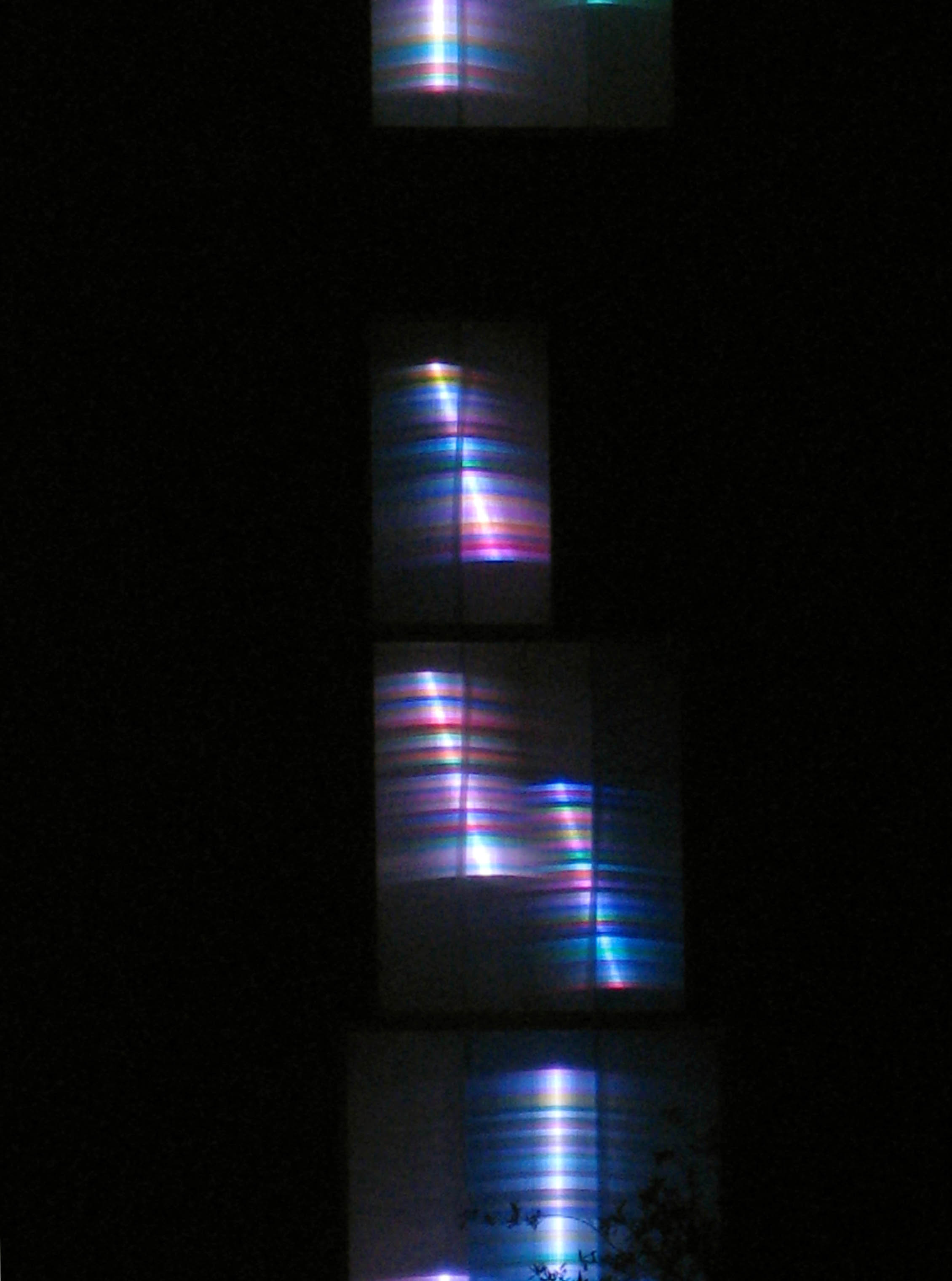 One and Many, Woven Light Two Towers Tall, Skypoint Tower, Overlooking Tampa Museum of Art. Public Art Commission, Florida 2007-  Two - 100' x 14 x 4' Tinted Reflective, Greenhouse Polycarbonates, Steel, Aluminum, Billion Color Continuously Changing Programmed LED Light