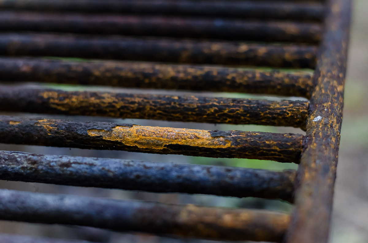 A corroding grill over a fire pit